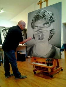 Illig at work in the studio.  Painting in progress.